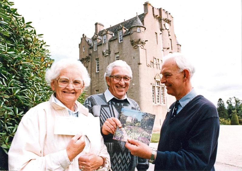 1991: Lucky 100,000ths visitors to Crathes Castle, Robert McMillan and his wife Peggy receive membership of the National Trust for Scotland from Jeffrey Boughey (right), administrator at the castle. Historic Crathes Castle has given a very special welcome to a very special visitor.  Its owners treated Bob McMillan and his wife Peggy to a years family membership of the National Trust and a slap-up lunch. For he is the castles 100,000th visitor of the season. Bob, a maintenance officer with Dundee District Council, was taken by surprise when he drove into the grounds during a holiday with friends.