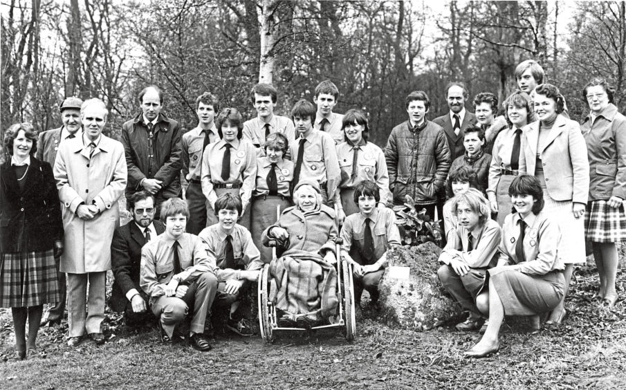 1983: Banchory woman Miss Bessie Brown (centre) is joined by Banchory Venture Scouts and National Trust officials after she had unveiled a plaque to officially open a nature trail for the disabled at Crathes Castle yesterday. The trail was mainly constructed by the Venture Scouts. Three wheelchairs for use on the trail were presented yesterday  two from the Kincardine and Deeside Members Centre of the Trust, and one from youngsters at Banchory Academy in memory of pupil Ian Thomson, Birkenbaud, Crathes, who died in a road accident on February 4.