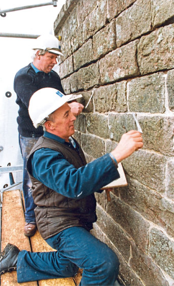 1990: Mr Alex Ramsay, Lumsden, and Mr Alex Bowman (front), Inverness, demonstrate methods of pointing a wall in Crathes Castle garden.