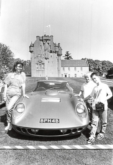 1988: Admiring one of the more recent vehicles on the Motor Tour, a 1964 Works-Le Mans A.C. 4.71, is Sheila Smith with her son, Paul (right) and friend Andrew Cowie (9), all from Banchory. A similar vehicle clocked 185m.p.h. on the M1-before the 70m.p.h. motorway speed limit was introduced. Crathes Castle was one of the stopping-off points for some of Scotland's vintage racing vehicles en route to Edinburgh at the weekend. The Scottish Historic Motor Tour paid a visit to the Castle on Saturday as they made their way to Ingliston from Glasgow  via Pitlochry. The tour gave the public a chance to see at close quarters some of the famous sports racing cars of the 1950s. Around 500 people turned up for the event. The number of visitors to the Castle nearly doubled yesterday for the afternoon performances of Banchory Pipe band.