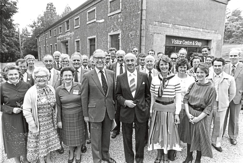 1984: Guests and officials gather before the ceremony to open the visitors centre at Crathes Castle yesterday. Centre are Scottish Tourist Board chairman Mr Alan Devereux (right) and National Trust for Scotland director Mr Lester Borley (left).