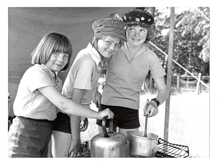 1977: Taking their turn to cook the lunch are (left to right) -  Elaine Smart (10) of Montrose Drive. Lynda MacDonald (14), of Ruthrie Terrace and Julie Henderson (13), of Kaimhill Circle.