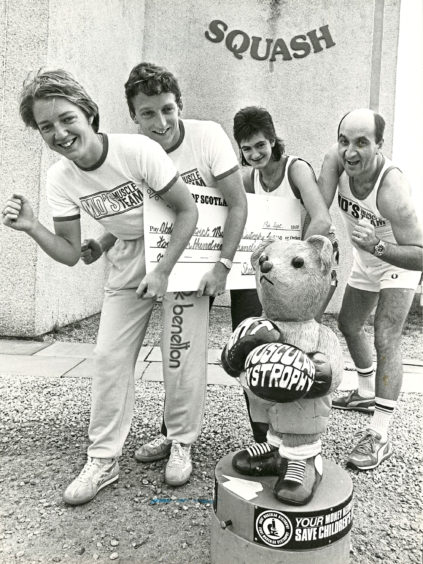 1988: Four Dyce Squash Club members have helped collect a cheque amounting to £1400 from a 10 kilometre (6 miles) Fun Run they took part in with other members earlier this year. The recipients will be the Muscular Dystrophy charity and the fund raisers left to right - Sarah Best, James Dufty, Alison Mutch and Denis Gratten.