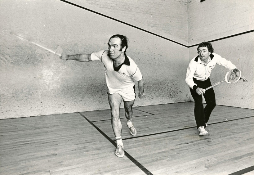 1981: In his 3rd round match in the Grampian TV Squash Championship, Graham Beattie (left) - the No. 12 seed fires a back hand shot for position against No. 2 seed Ian Donald. Ian went on to win the tie.