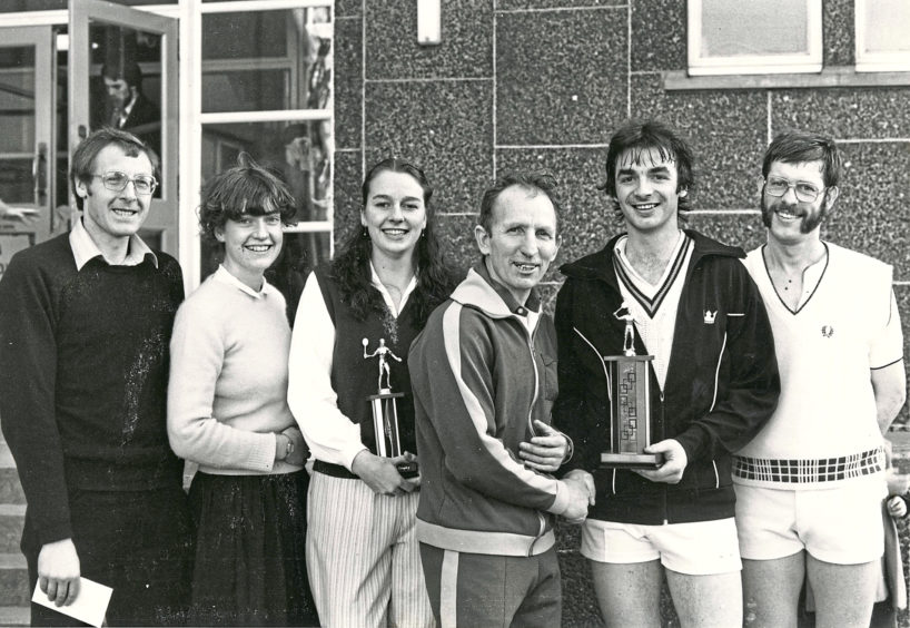1982: Prizewinners at the Butchart tournament (left to right) - Sue Robertson (women's runner-up), Gail Wiggins (women's champion), Eric Farr (organiser), Sandy Adam (men's champion) and Mike Moore (runner-up).