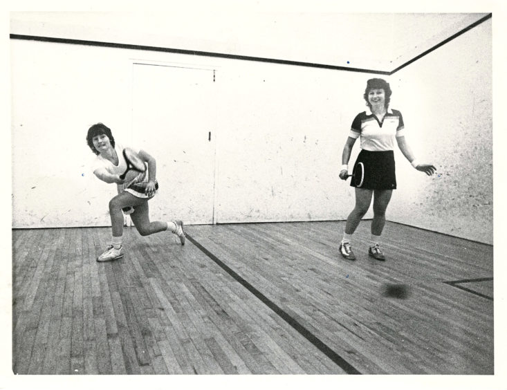 1983: The North of Scotland squash championships continued at Mannofield today. Green Final photographer Donald Stewart was there to capture the action. Pictured is Kathy Archibald (Aberdeen) makes a fine return of serve in her match against Trish Masterton (Dunfermline, right).