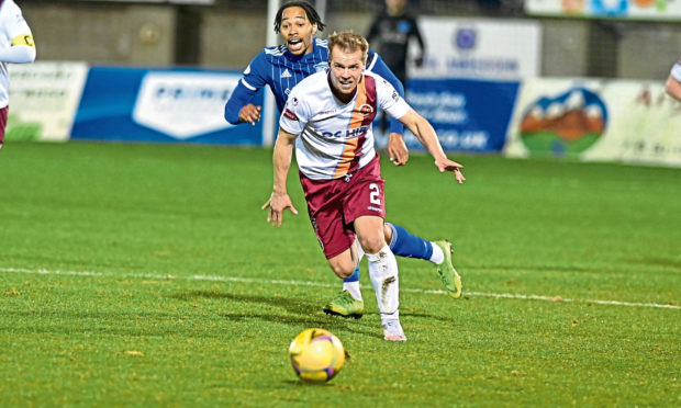 Peterhead striker Niah Payne and Jonathan Tiffoney. Picture by Paul Glendell