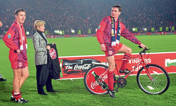 Stephen Glass tries out his man-of-the-match prize to the amusement of Aberdeen team-mate Eoin Jess (left) after the 1995 Coca-Cola Cup final.