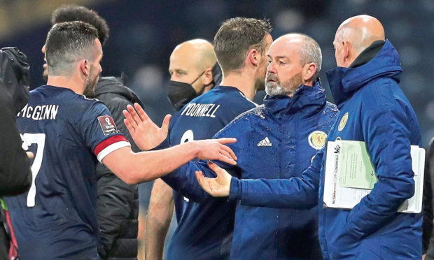 Scotland's John McGinn (left) shakes hands with manager Steve Clarke after the 2-2 draw with Austria.