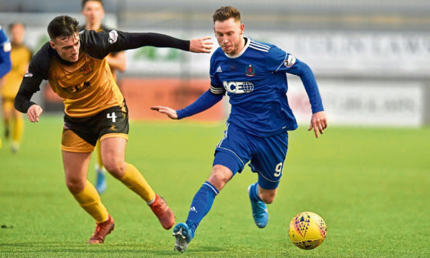 Mitch Megginson on the ball for Cove Rangers.