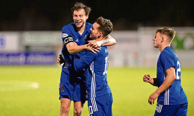 Cove's Jamie Masson, right, and Mitch Megginson celebrate after Cove make it 2-0 against Airdrieonians on Tuesday.