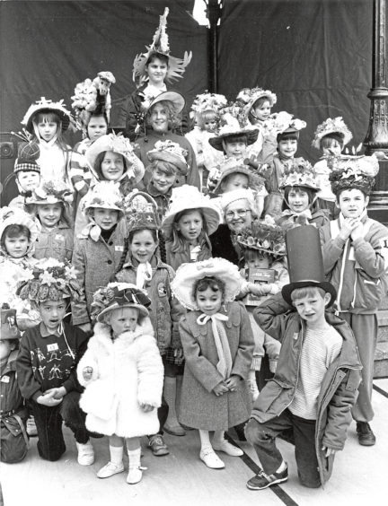 1988 - Lady provost Margaret Rae is surrounded by children who took part in the Easter Bonnet parade in St Nicholas Centre, Aberdeen, on Saturday in conjunction with this years Scottish Connection festivities. The lady Provost presented the prizes.