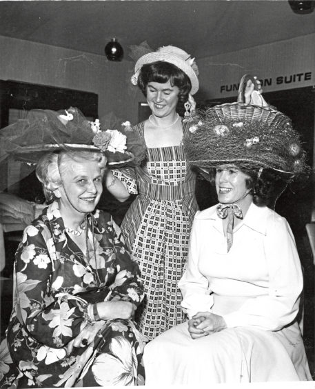 1978 - A heady experience for three members of the Petroleum Womens Club of Scotland as they show off their Easter bonnet creations during their get-together at the Westhill Inn. Left to right  treasurer Mrs Gerda Stamm, organiser Mrs Isobel Edwards and activities chairman Mrs Brenda Artopeous.