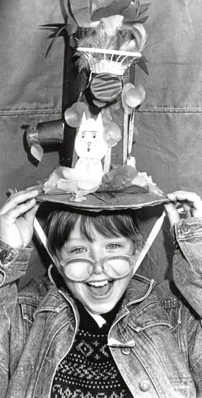 1990 - 'Anything goes when you create an Easter bonnet. Here nine-year-old Lynne Donald, 22 Newlands Avenue, Aberdeen, a pupil at Broomhill School, is pictured wearing her own creation ''Easter Tree'' at the Easter bonnet parade at the St Nicholas Centre, Aberdeen.'
