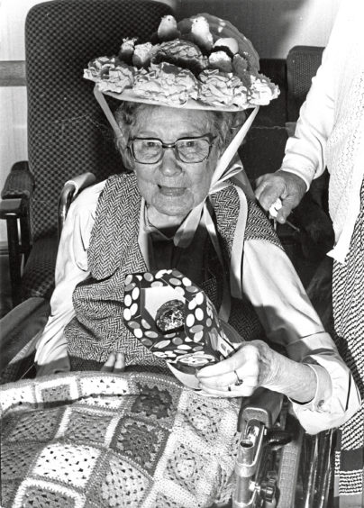 1988 - Here is my prize  Miss Elsie Michie has a treat in store  her newly-won Easter egg  after taking first prize in the Easter bonnet parade at Hillside House Nursing Home, Banchory.