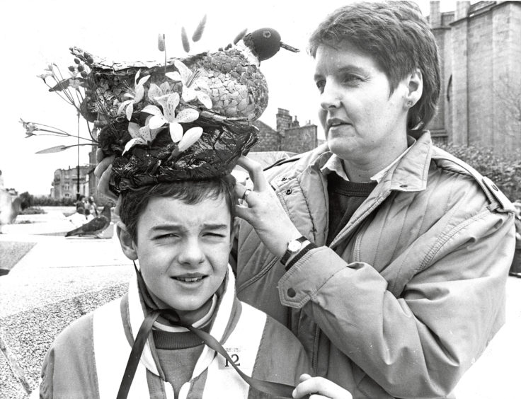 1988 - Inverness youngster Ruairidh Nicolson gets some last-minute adjustments to his millinery creation from mum, Brenda, before the Easter bonnet parade, part of the Scottish Connection festivities, held in the St Nicholas Centre, Aberdeen, on Saturday.