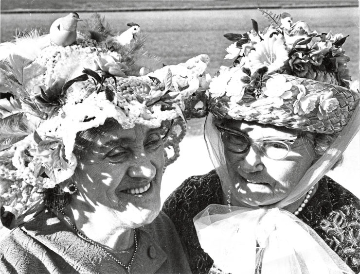 1970 - In their Easter bonnets  Miss J. Angus (left) and Mrs C. Sheret at a showing held by St Clements OAP Club in the dining hut, Hanover Street School.