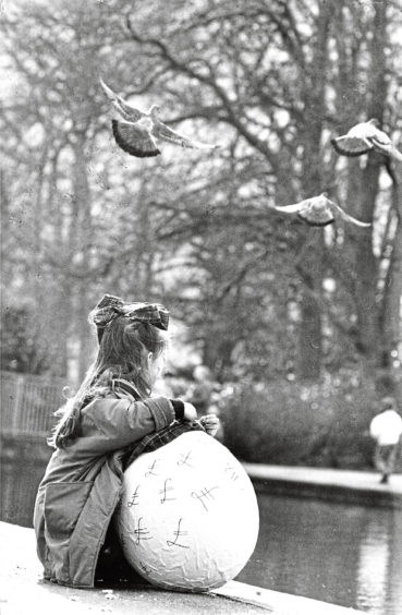 1989 - 'Nice day for the birds… and Easter. Jenny Milne (7), Milltimber, was doing her good deed for Easter by carrying a huge Easter egg advertising ''Fresh Air'' the students' show in HM Theatre. But little girls get tired and feeding the pigeons in the Duthie Park is also a nice way to spend an Easter Day.'