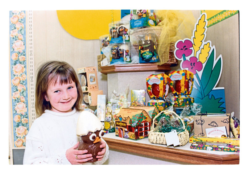 """1993 - """"In an eggshell: taking a close look at the Dizzy Duck display at Marks and Spencer is five-year-old Mandy Bennett, Cairn Crescent, Cults, Aberdeen."""""""