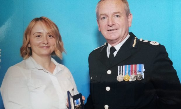 PC Alison Cameron and Police Scotland Chief Constable Iain Livingstone at her long service medal ceremony in 2019.
