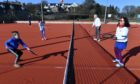 Youngsters Archie Dinnett, 8, Lily Metelski,7, try out the new playing surface at Stonehaven Tennis Club with senior members Ben and Diete Juffermans.