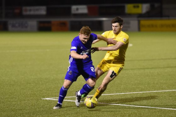 Cove midfielder Fraser Fyvie under pressure from Airdrie's Paul McKay