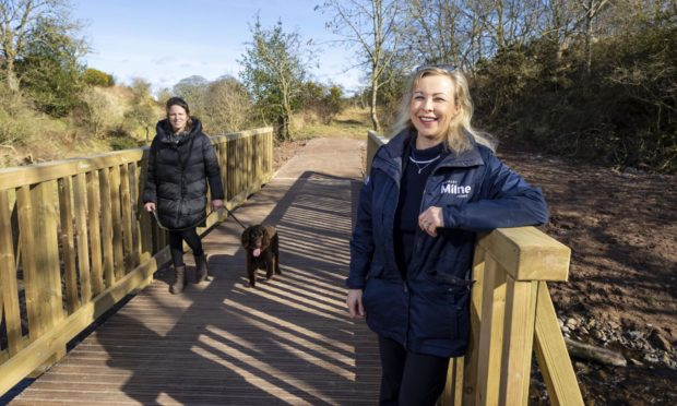 Claire Forbes, sales consultant at Stewart Milne Homes, alongside Alison Will, Dunnottar Park resident with her dog Reggie.