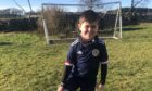 Cameron Marr is raising funds and awareness about food allergies by scoring goals in his back garden