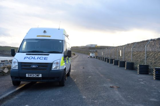 Police at the Aberdeen Harbour site.