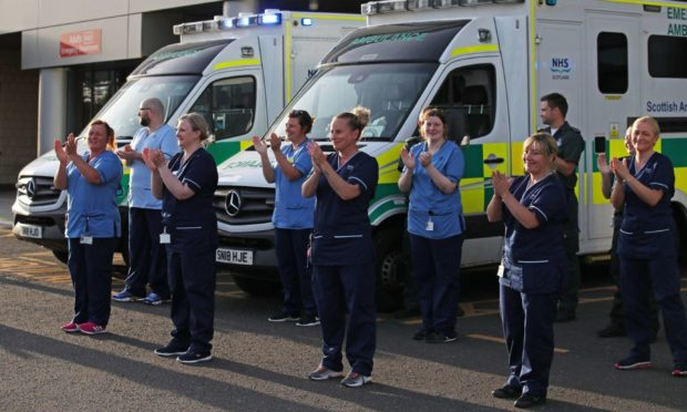 """NHS staff across Scotland have been praised for their efforts during an """"exceptionally challenging year""""."""