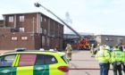 Crews tackle the fire at Northfield Academy yesterday. Picture by Kami Thomson