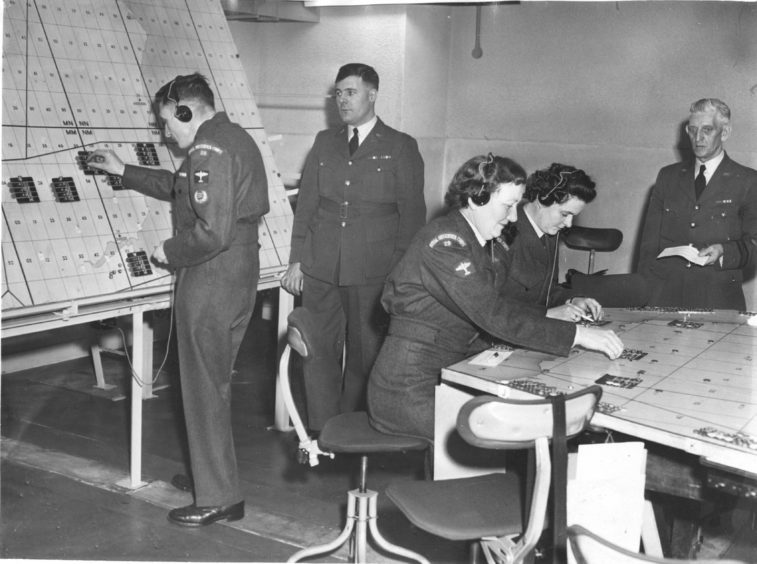 1961 - Members of the Royal Observer Corps at work in the Control Room in the new operation centre at Quarry Road, Northfield. The centre was officially opened in May 1961