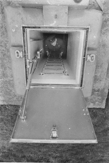 1975 - Fifteen feet under the ground, the entrance to an underground monitoring post.