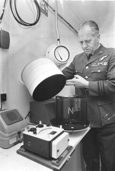 1975 - Lt. Commander Johnston checks the apparatus used to check a bomb's position