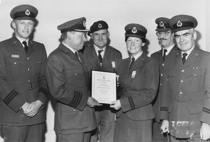 1986 - A double presentation for long service to Observer Lt. Carole Allerton and Observer John Henderson