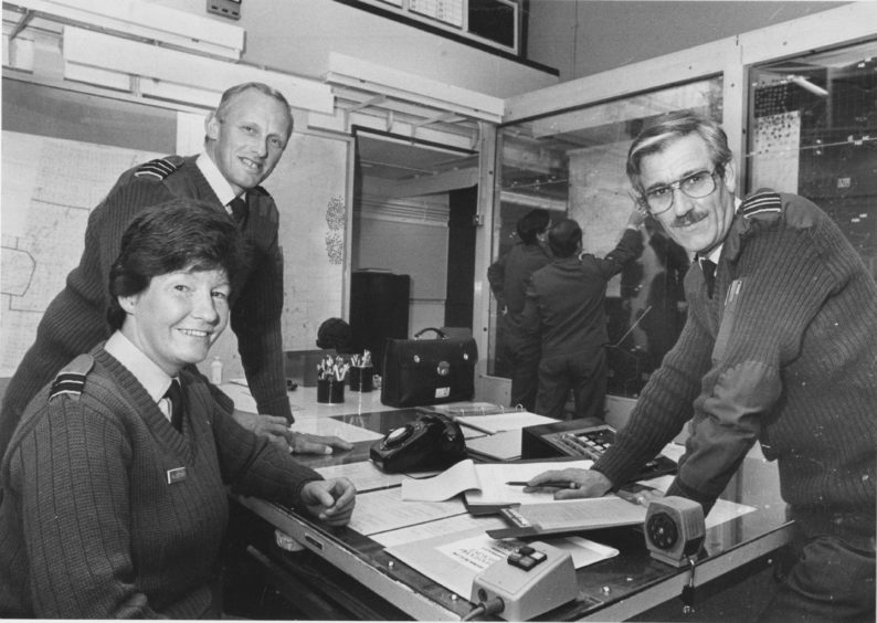 1987 - Group Commandant Gordon Martin, at rear, Crew Officer Carol Allerton and Deputy Group Commandant Ian Snedden