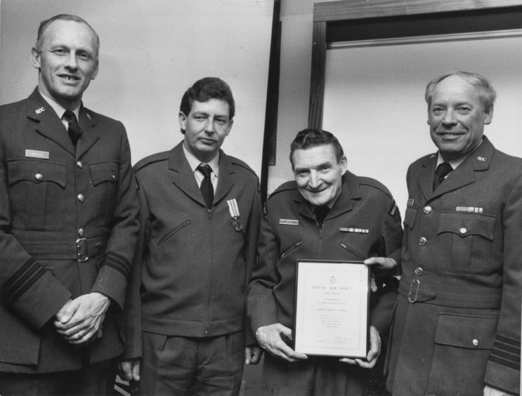 1988 - service certificate is presented to Chief Observer Sandy Reid and the ROC Medal to Alan Alexander McWilliam