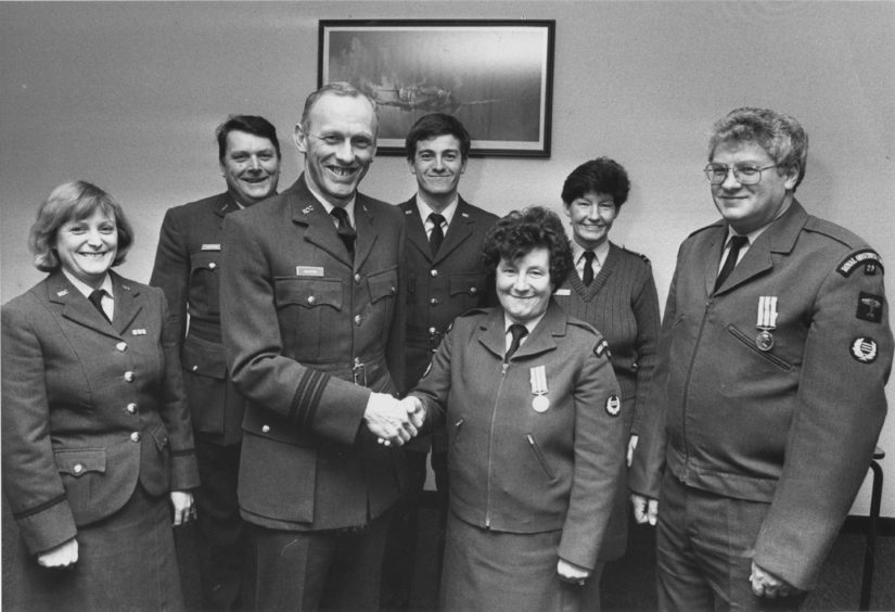 1989 - Medals for long service for Leading Woman Observer Irena Townend and Chief Observant James Cockie
