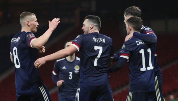 Scotland's John McGinn (centre) celebrates with Scott McTominay after scoring.