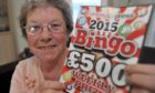 Moira Napier, pictured the last time she won the EE bingo.