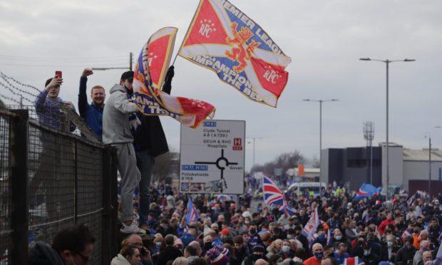 Rangers fans celebrate the Glasgow side winning the league.