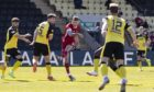 Aberdeen's Callum Hendry scores to make it 1-0 during the Scottish Cup tie at Dumbarton.