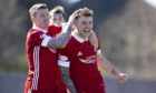 Callum Hendy, right, celebrates his winning goal against Dumbarton with Jonny Hayes.