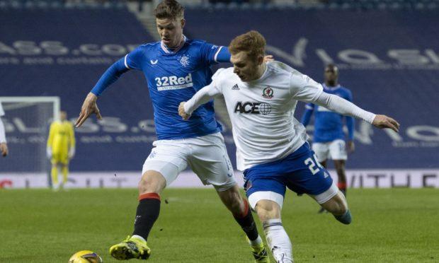 Fraser Fyvie of Cove tussles with Rangers striker Cedric Itten.