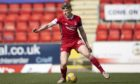 Jack MacKenzie in action for Aberdeen against St Johnstone.