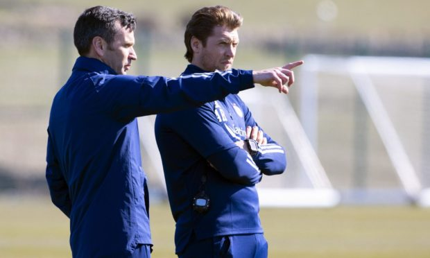 Stephen Glass (L) chats with his assistant Allan Russell during training.
