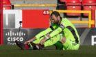 Aberdeen goalkeeper Joe Lewis is injured during the Scottish Cup tie against Livingston.
