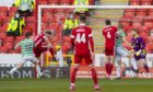 Aberdeen's Lewis Ferguson makes it 1-0 against Celtic.