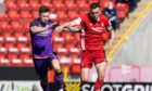 Aberdeen's Andy Considine (R) in action with Calum Butcher of Dundee United in the Scottish Cup.