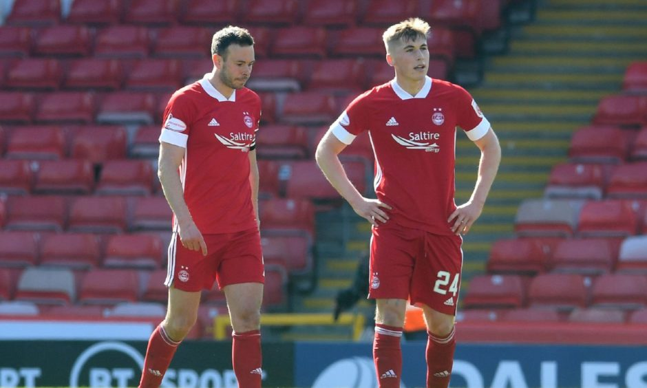 Aberdeen's Andy Considine (L) and Dean Campbell are dejected during the Scottish Cup defeat to Dundee United.